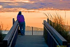 Woman watching sunrise Bethany Beach