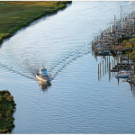 aerial_story_boat_on_canal-8000-150-150-100-c Above Sea Level - Delaware Beach Life